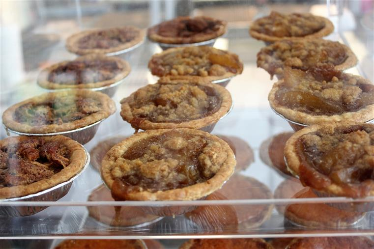 mini apple pies in a display case