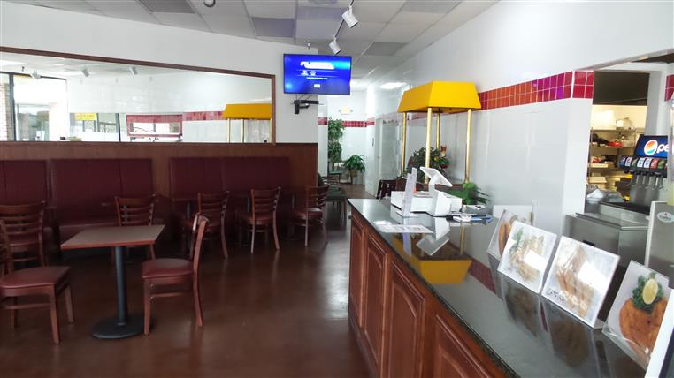 view of the counter and dining room