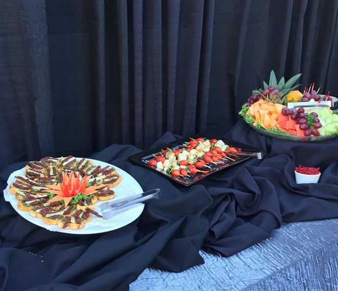 Variety of appetizers on trays atop table cloth