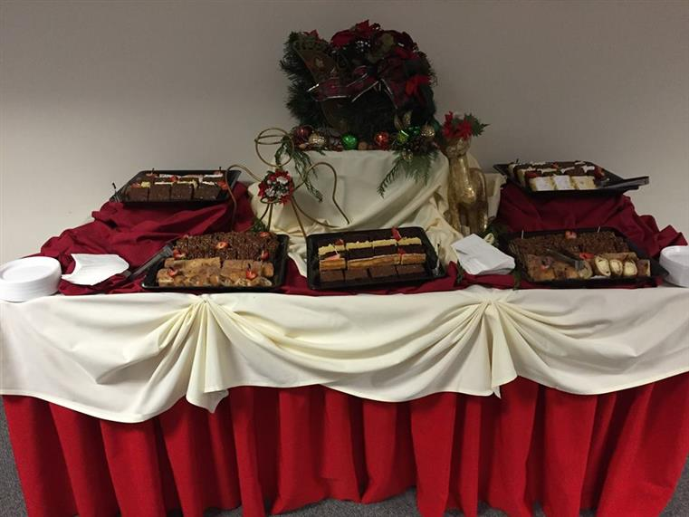 Holiday desserts on table with red tablecloth and white trim
