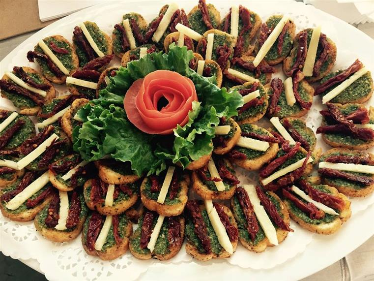 Appetizers on white serving dish
