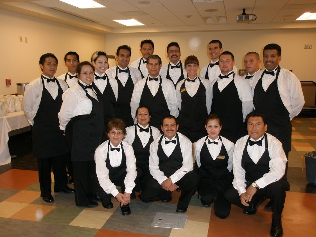 Catering staff posing for photo in banquet room