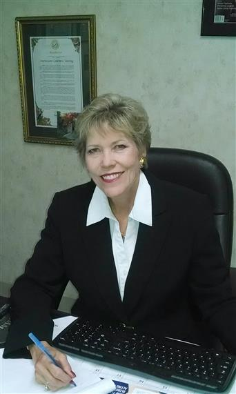 Sandra Forney at desk
