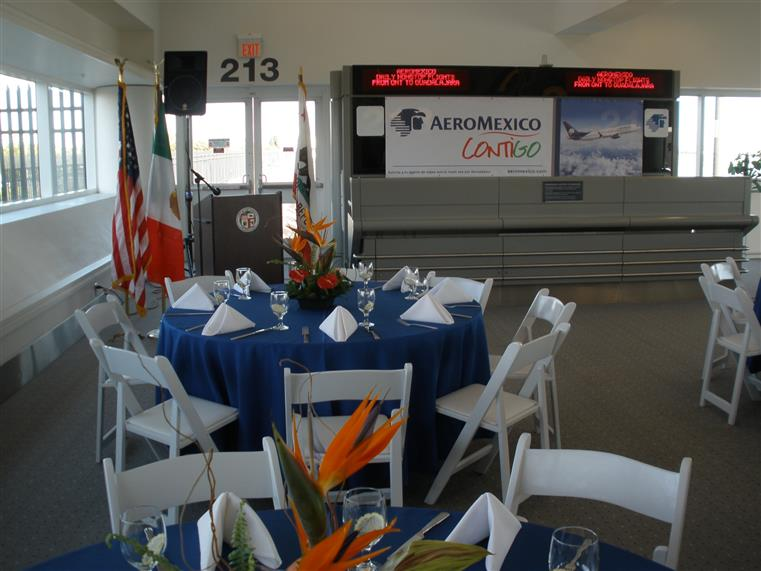 Aero Mexico banquet with blue-clothed table and white chairs