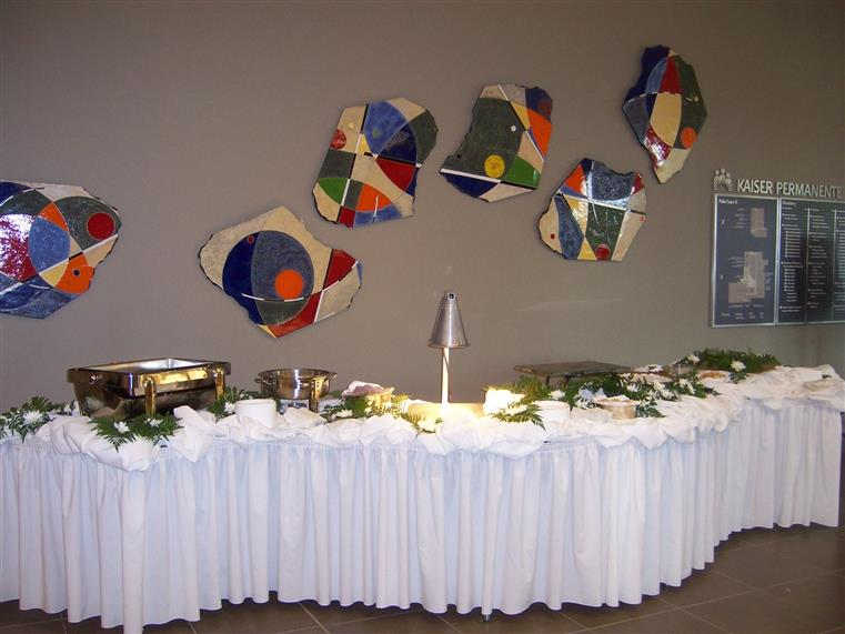 Fancy white-clothed banquet table with sternos
