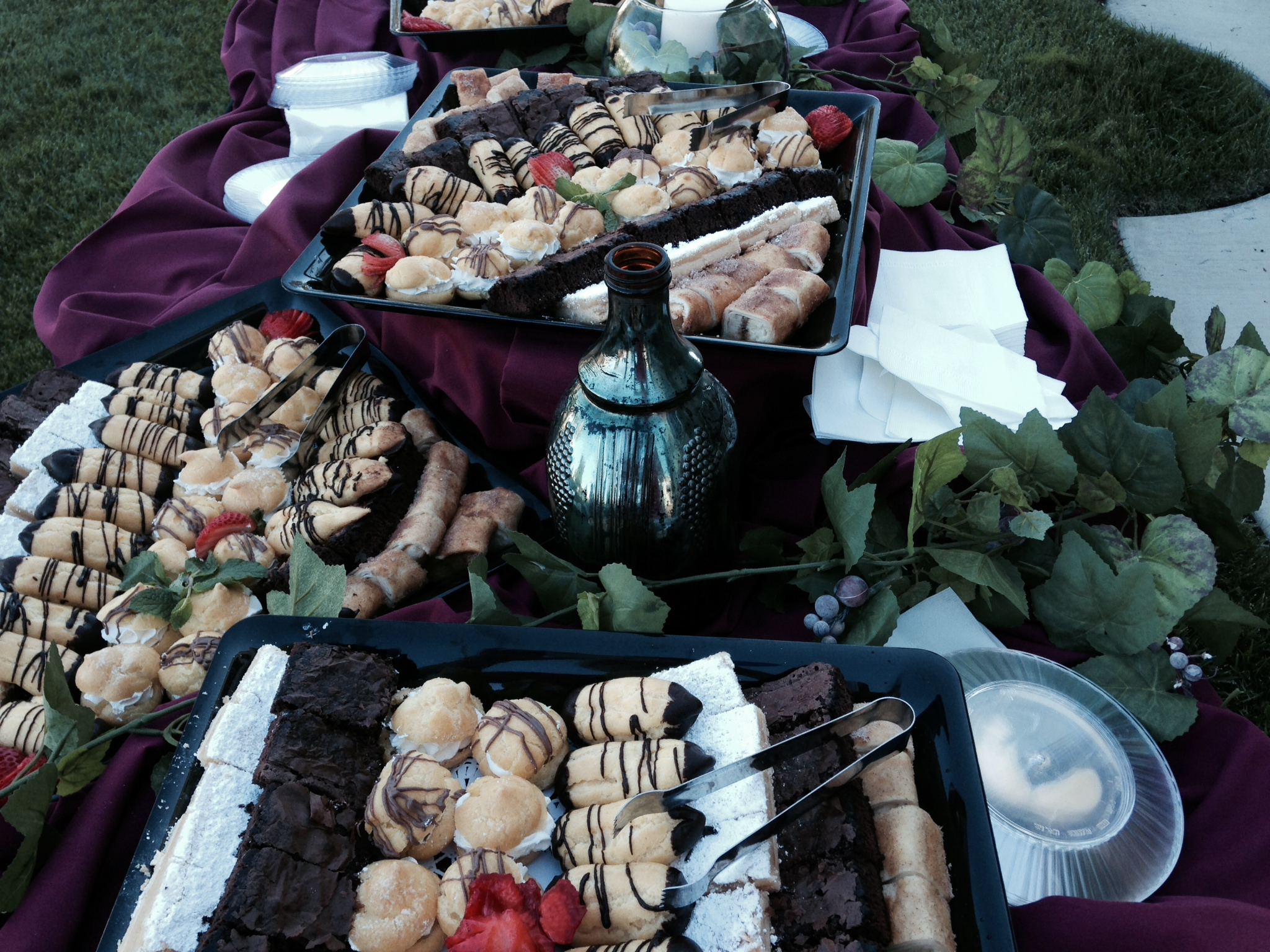 pastries and cakes on a catering table