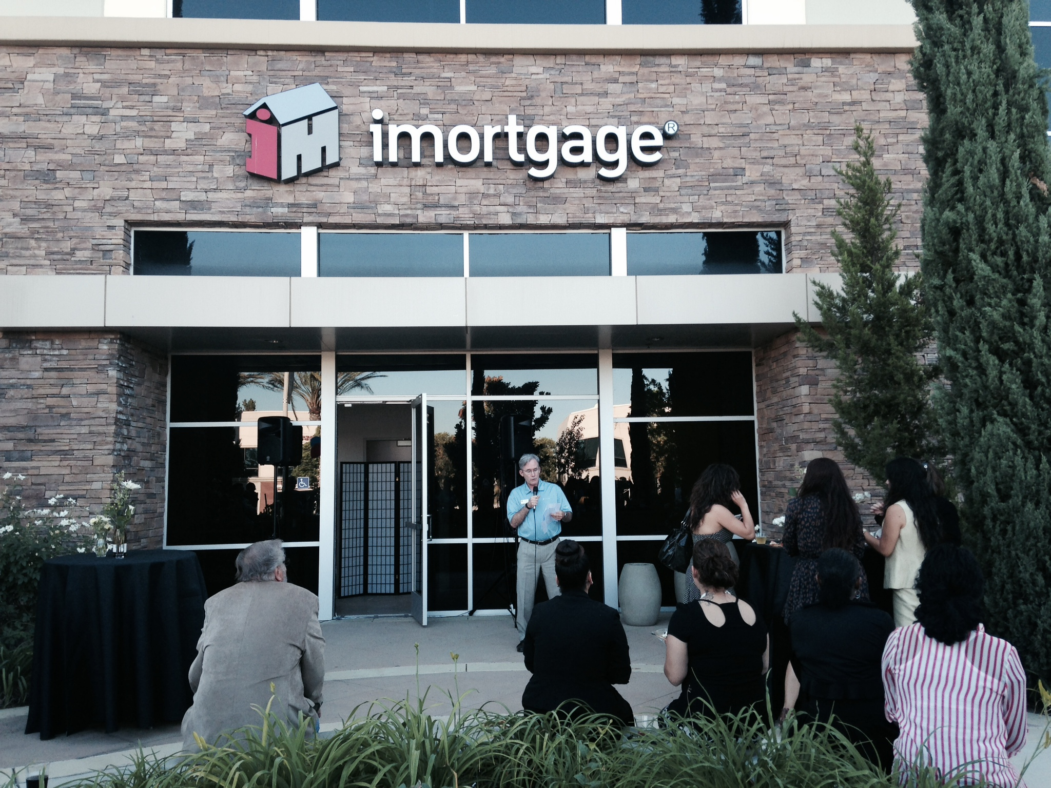 People standing outside a building marked imortgage