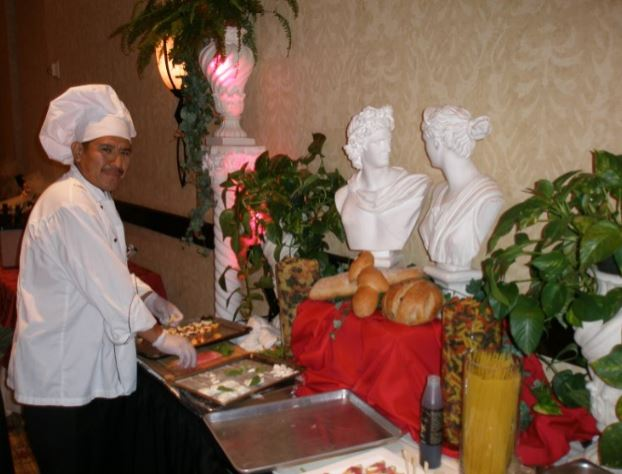 a chef placing out the catering food