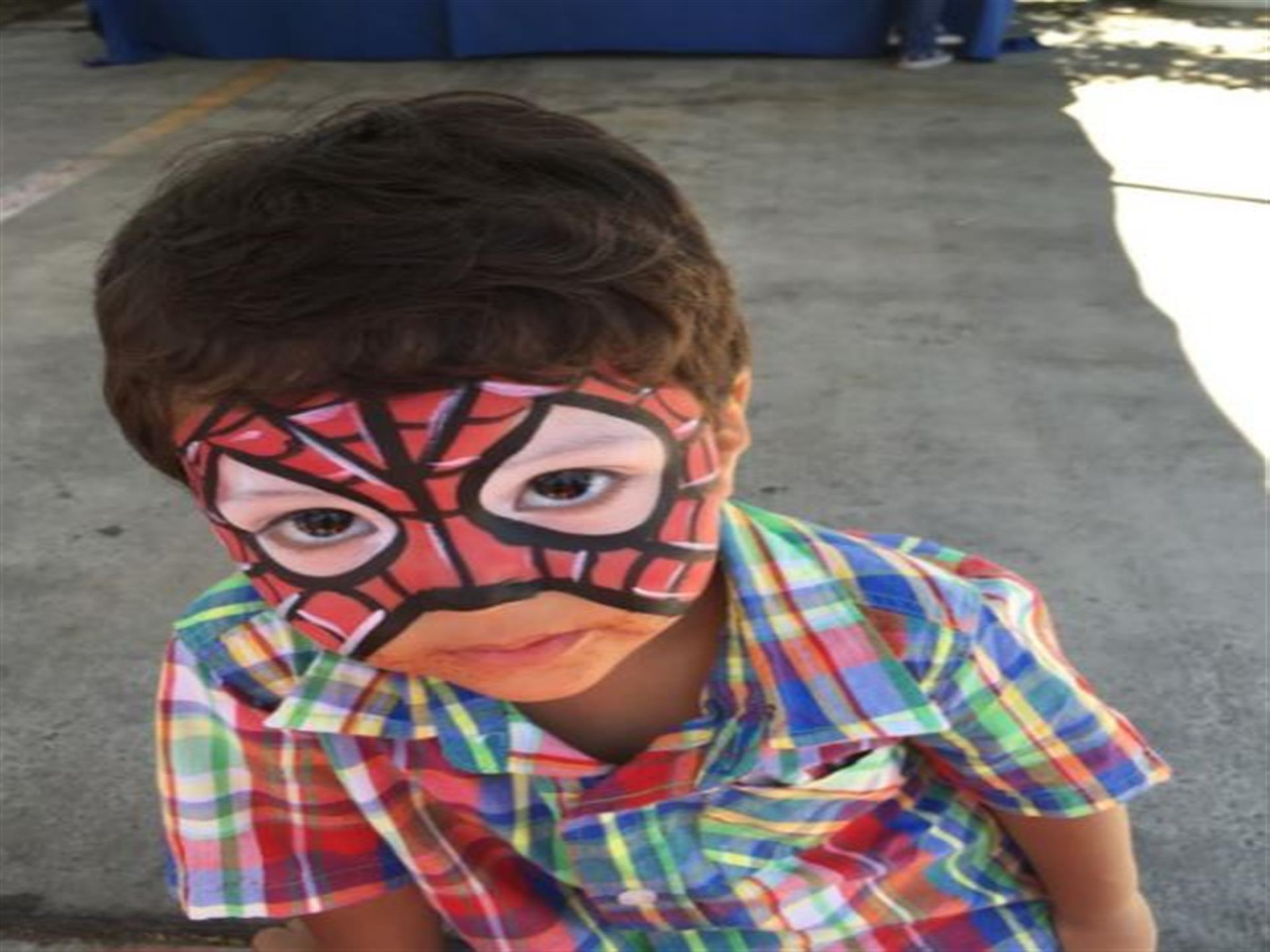 Young boy with spiderman facepaint