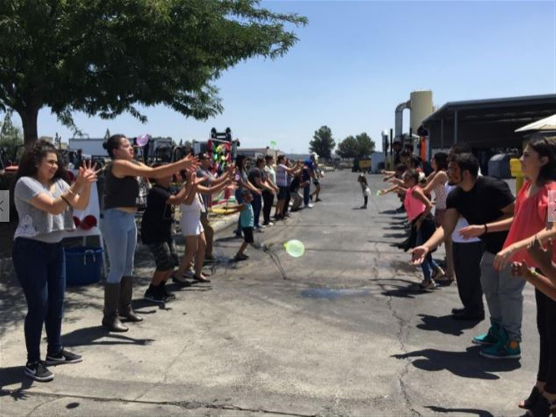 Children and teenagers playing balloon toss game