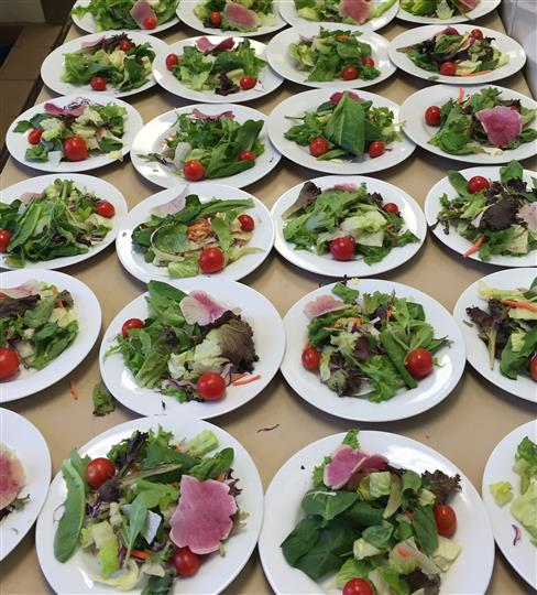 many plates of salad