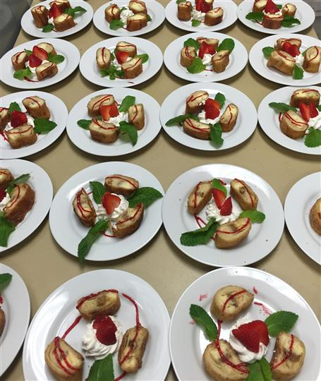 many plates of dessert with strawberries