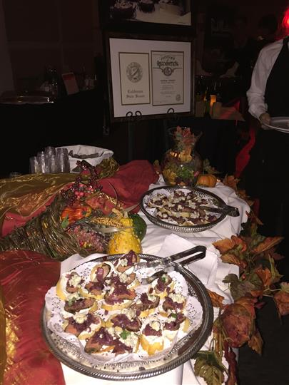 an autumn themed table with appetizers