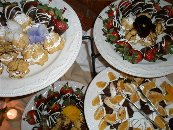 puff pastries, chocolate covered strawberries, and chocolate covered orange slices
