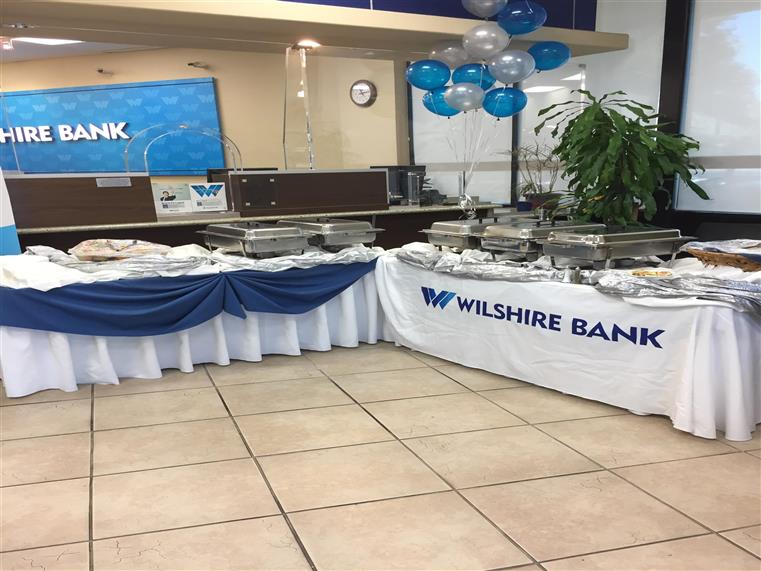 Wilshire Bank catered event. Sternos on white-clothed tables.