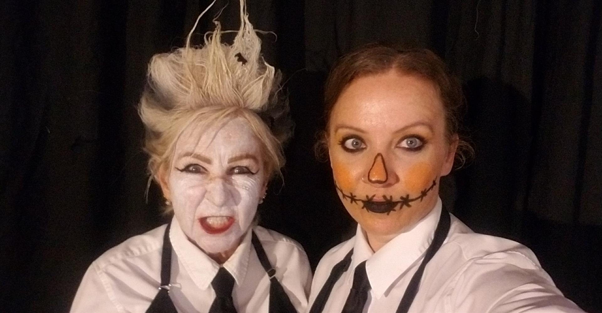 Two waitors dressed up in halloween facepaint
