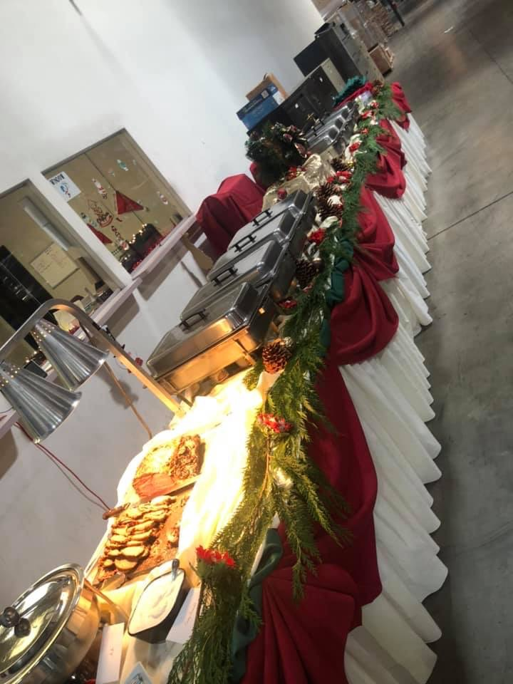 catering tables with platters of food and cahfing dishes on them