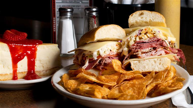 The Hoarder Sandwich: Roast beef, corned beef, turkey, pastrami, ham, coleslaw, French fries, Swiss & tomato on ciabatta.