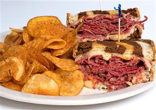 reuben sandwich with chips on the side