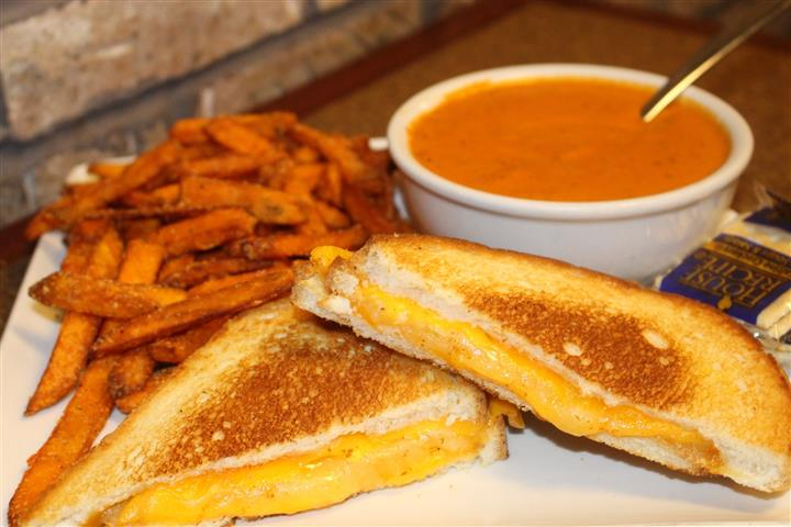 grilled cheese sandwich with sweet potato fries and tomato soup