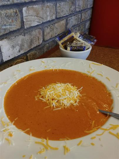 tomato soup with shredded cheese