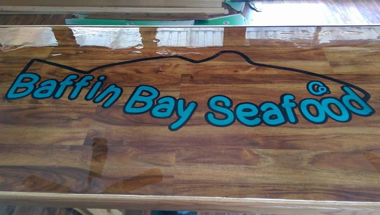 Baffin Bay Seafood logo on dining table.