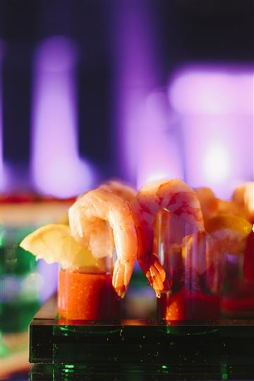 shrimp hanging off bloody marys