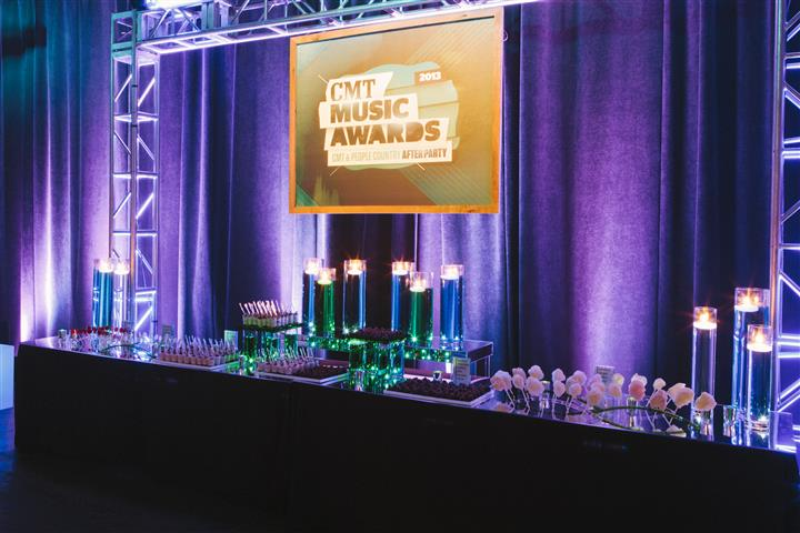 "dessert table with ""CMT Music Awards"" sign above"