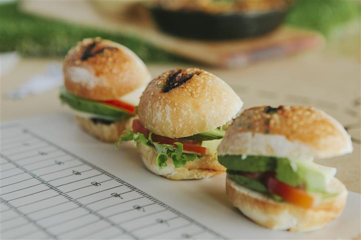 three mini sliders with lettuce and tomato