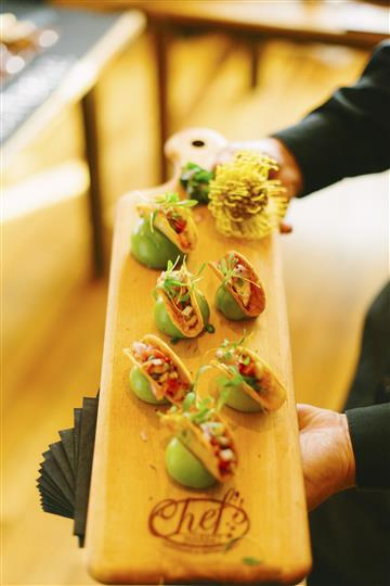 mini tacos on a wooden board