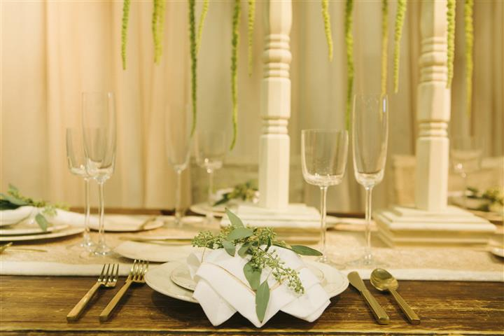 closeup of place setting with leaves on top of napkin
