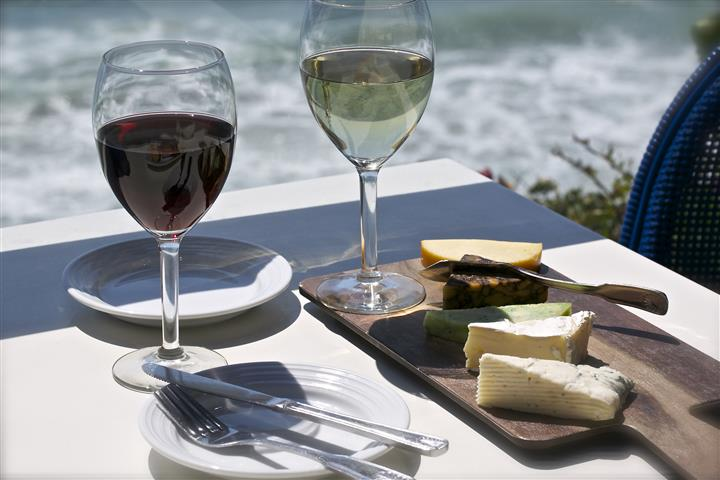 Cheese board with two glasses of white and red wine