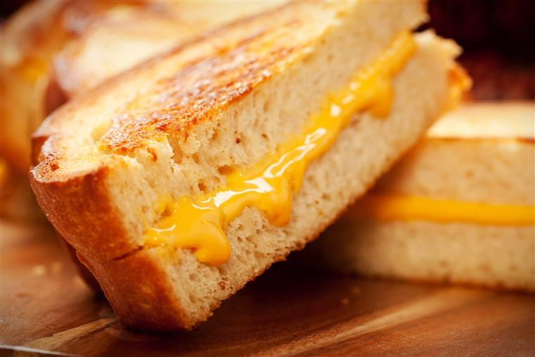 Grilled cheese sandwiches on cutting board