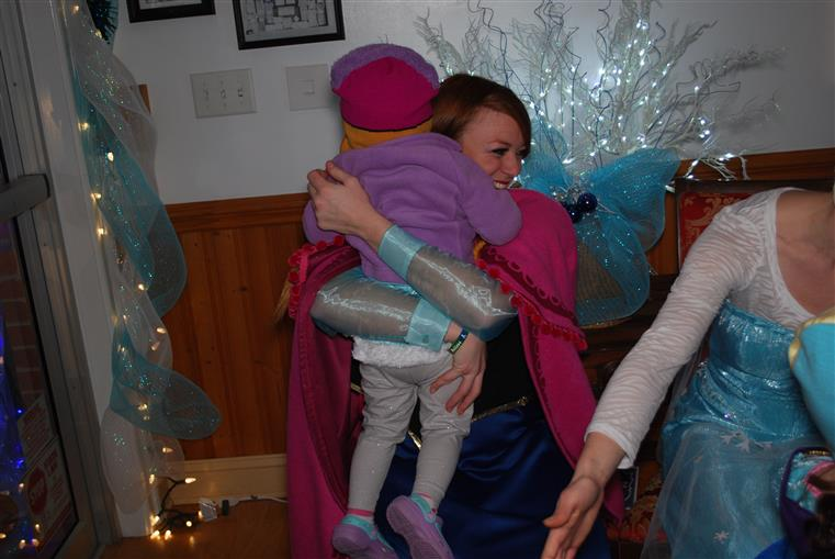 Anna from Frozen hugging a girl