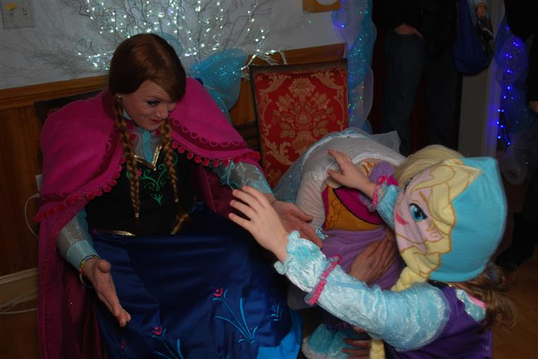 Anna from Frozen hugging child