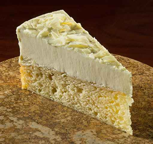 Italian lemon cake. Yellow cake with lemon cream finished with vanilla cake crumbs on the sides, dusted with confectioners sugar.