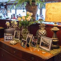 a table with picture frames and flowers