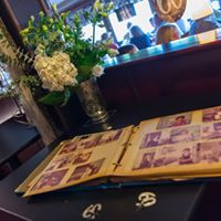 a table witha photo album and flowers
