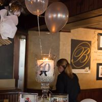 a table centerpiece with balloons
