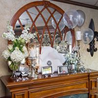 table with flowers, picture frames, and balloons