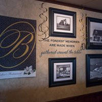 a wall at Bakers Restaurant with photos