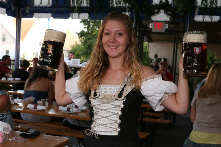 Lady holding mug of beer