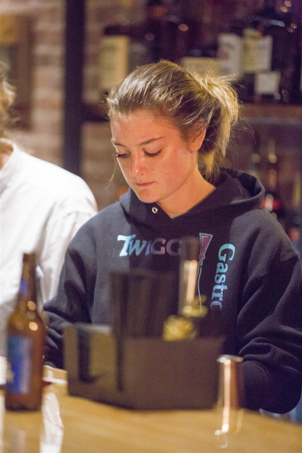 a woman at the bar