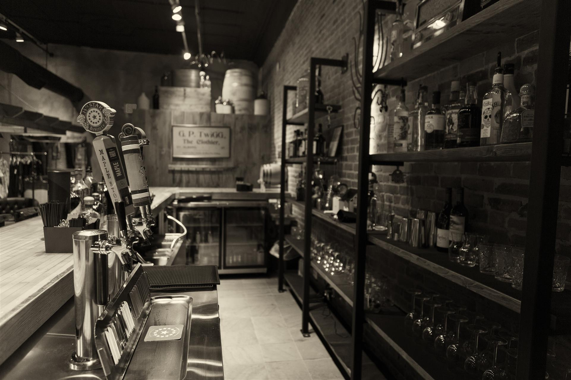 a black and white picture of the bar