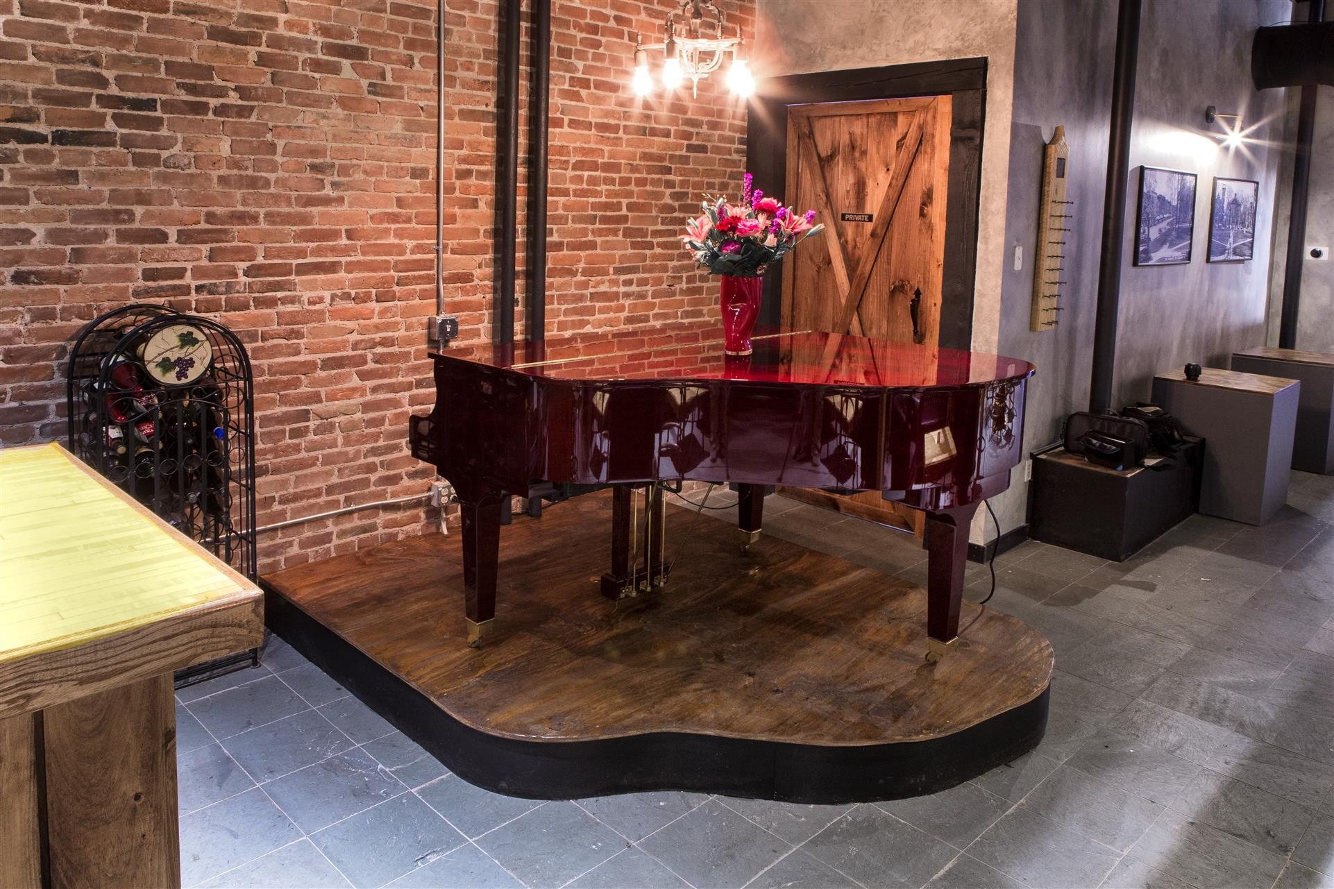 a piano with a decorative vase of flowers