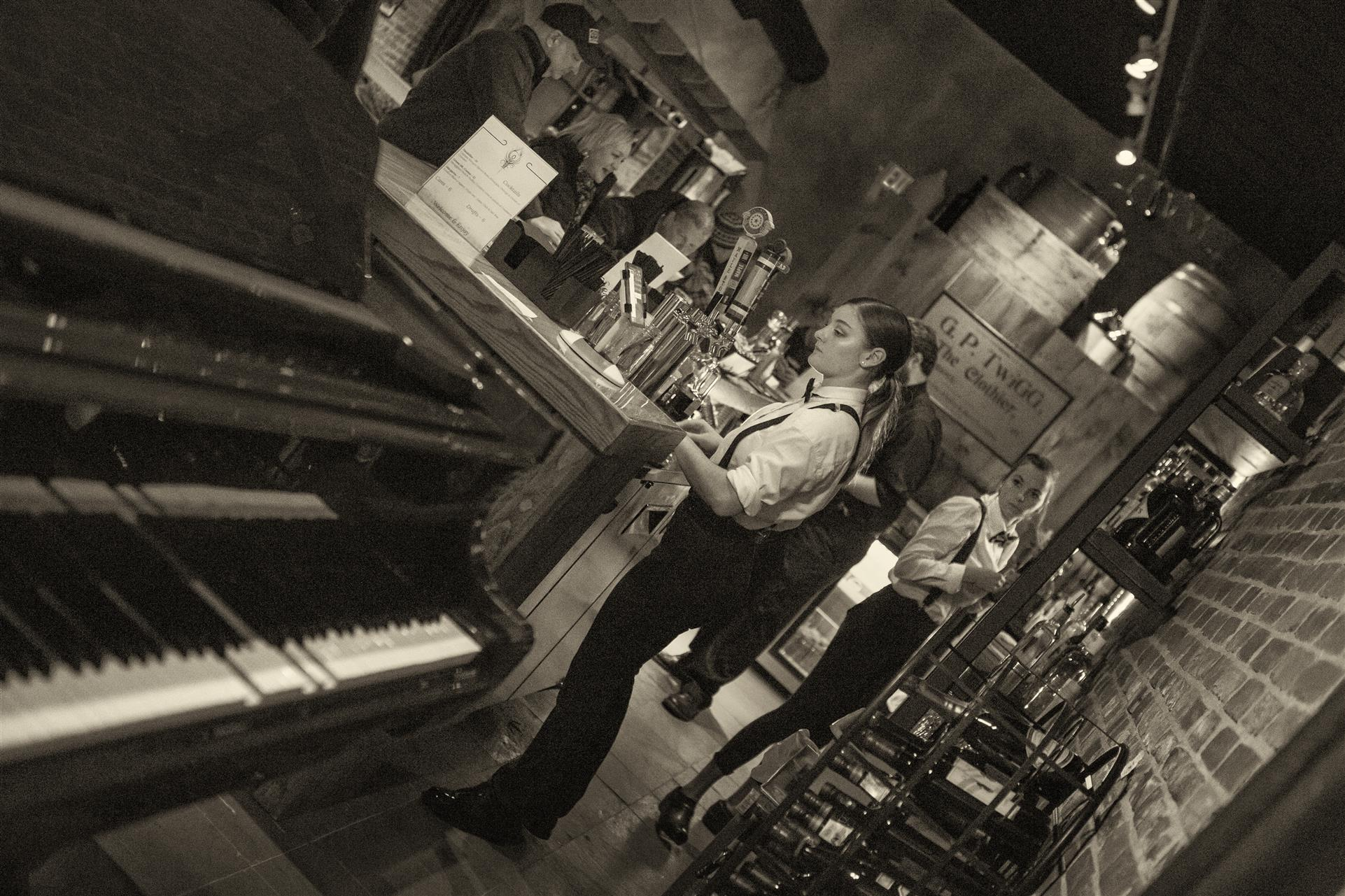a bartender, near a piano