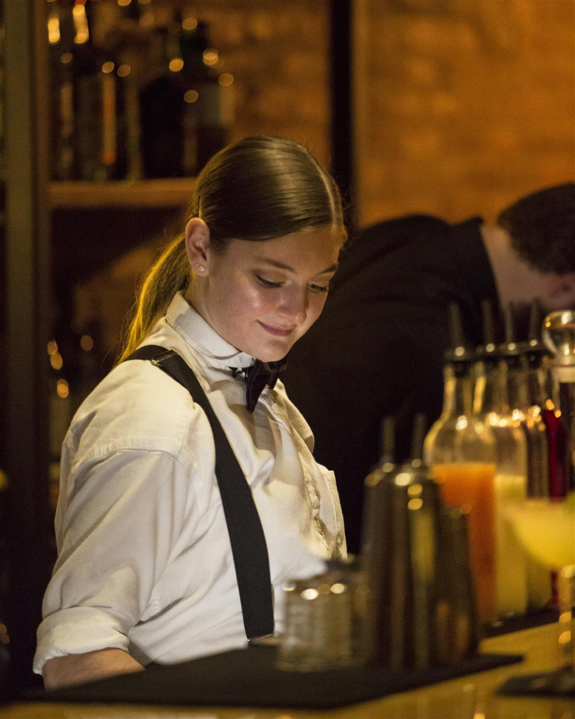 a bartender preparing drinks