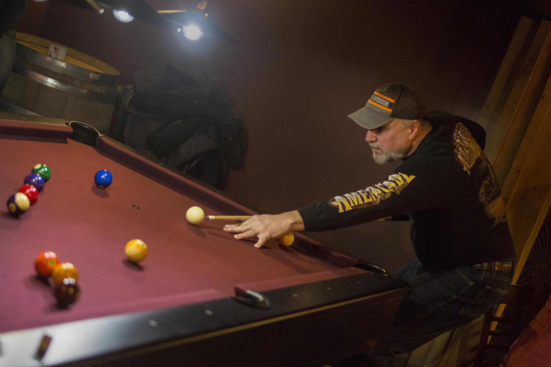 a man playing pool