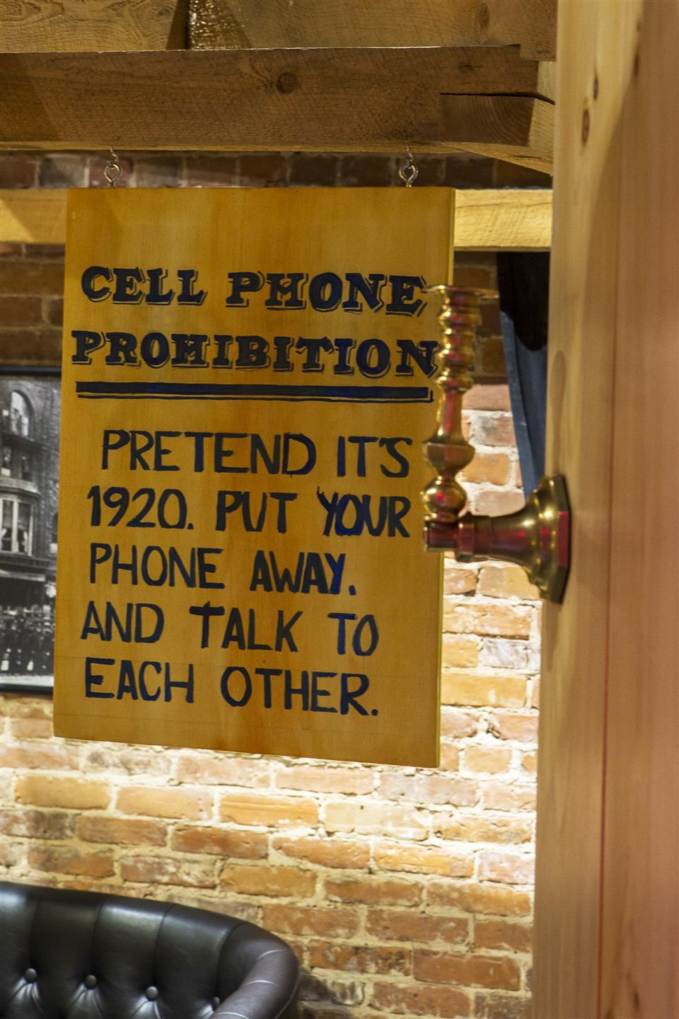 a sign discouraging cellphone use