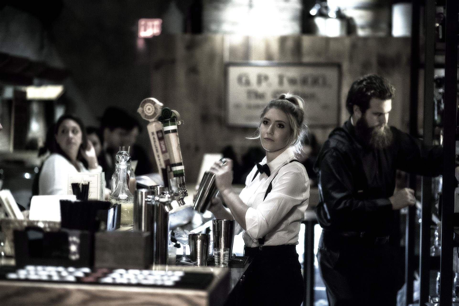 a bartender with a bowtie and suspenders
